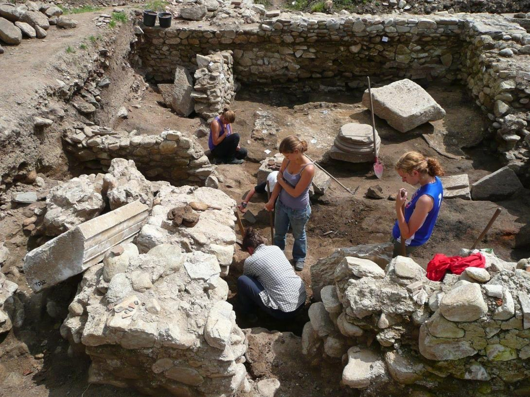 Projects Abroad volunteers are pictured taking part in a dig at an excavation site whilst on their volunteer archaeology work in Romania.